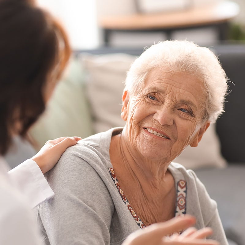 older woman with caregiver